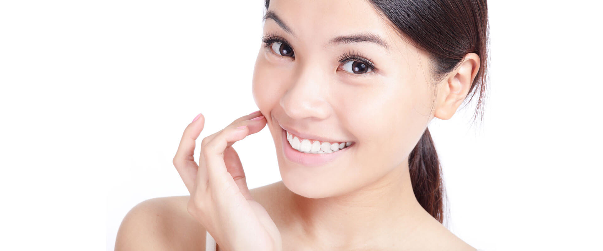 Beautiful young woman smiling at the camera showing bright white teeth