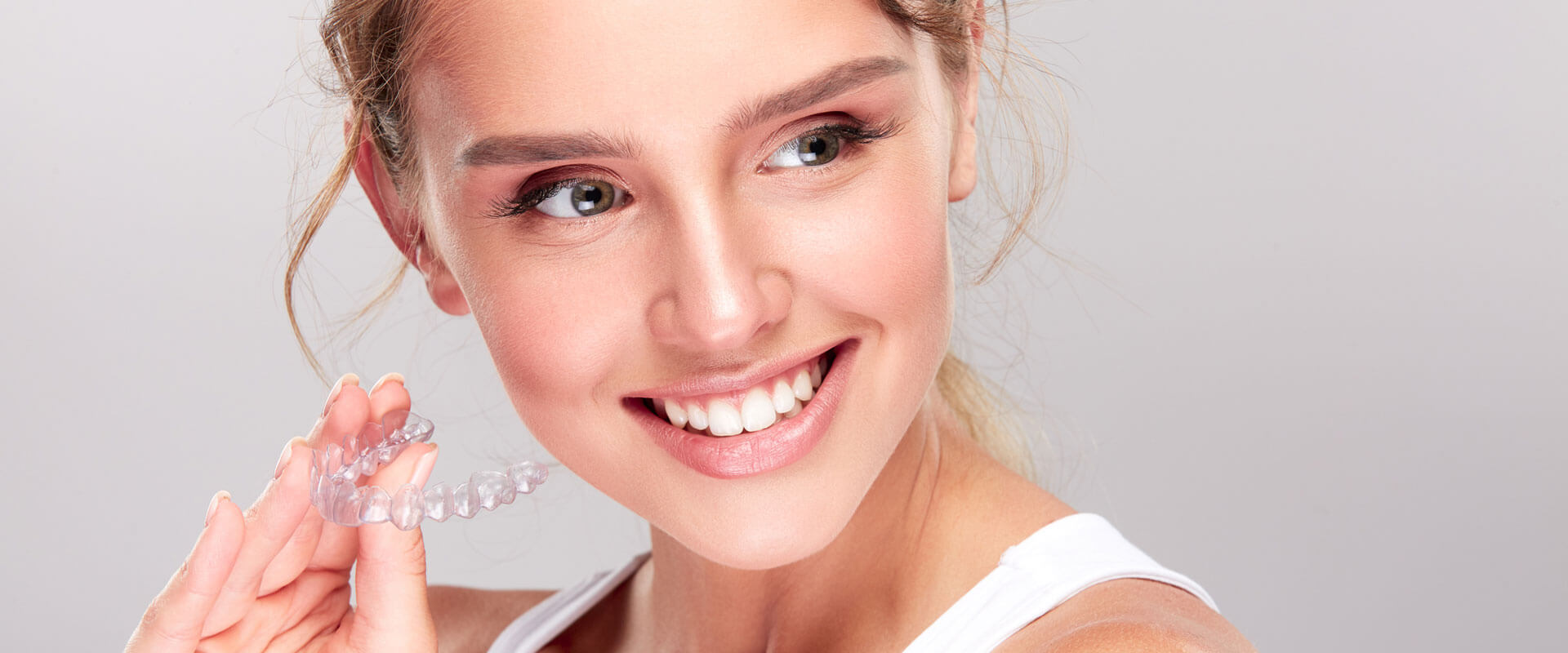 Young beautiful woman smiling holding dental equipment