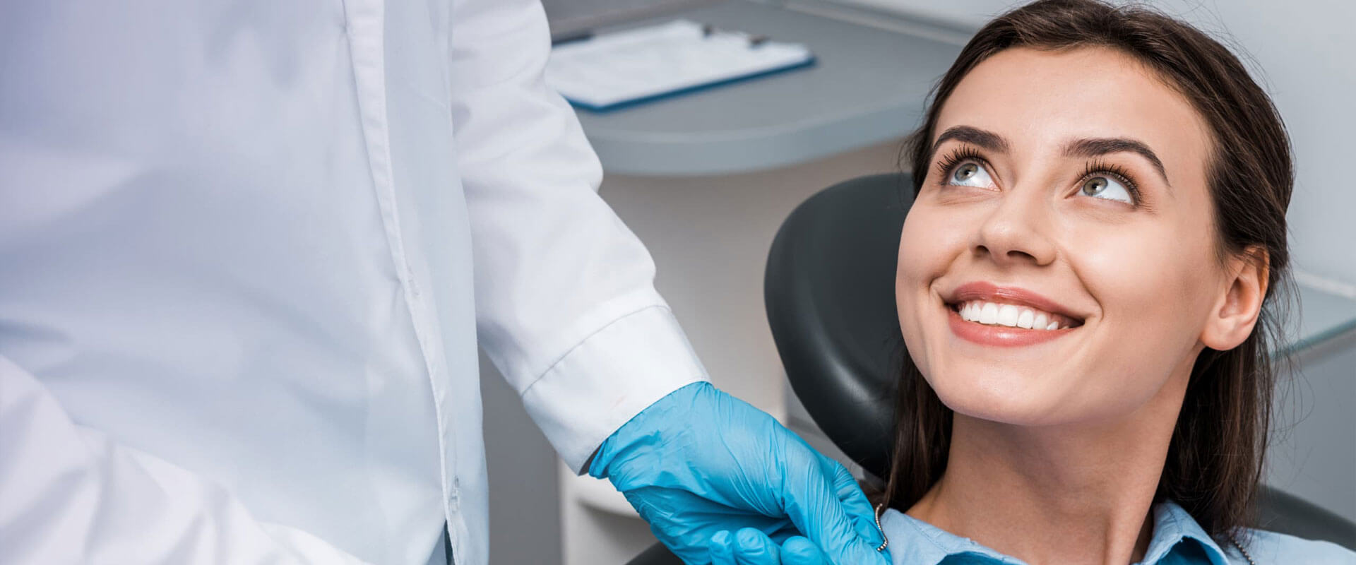 Beautiful young woman smiling looking at the Dentist