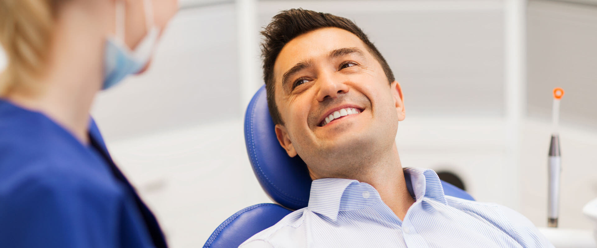 Male patient smiling about to receive root canal treatment