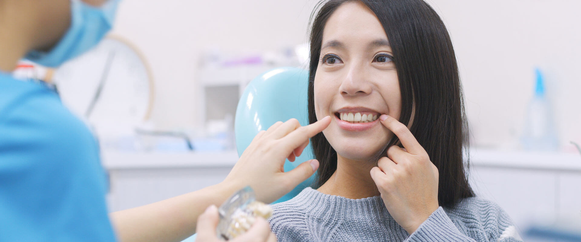 Female patient pointing at her tooth